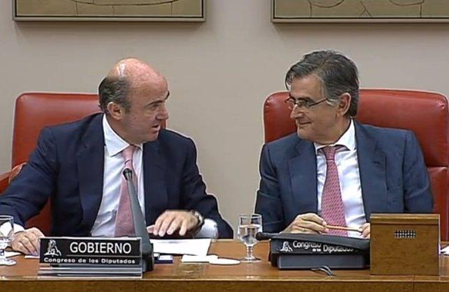 Guindos y Ovidio Sánchez en el Congreso