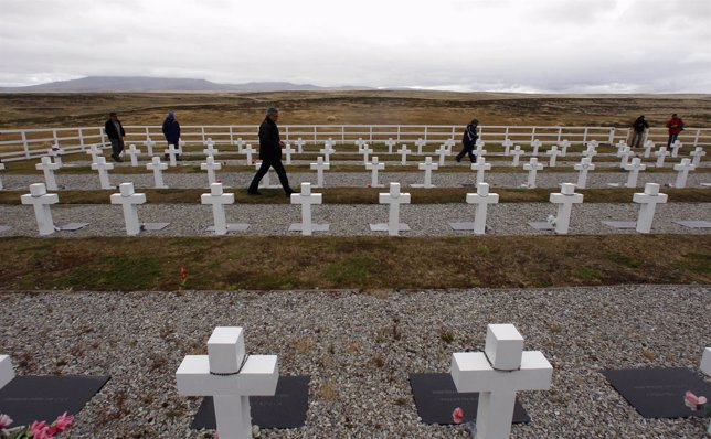 Argentine Falklands War veterans walk among the tombstones to pay homage to Arge