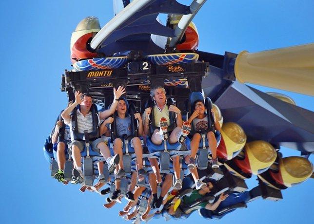 People ride the Montu roller coaster at Busch Garden
