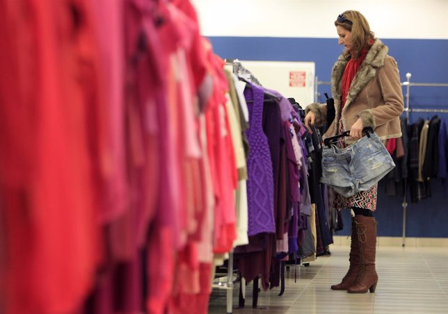 A customer looks at clothes on display at a store of a major second hand clothes