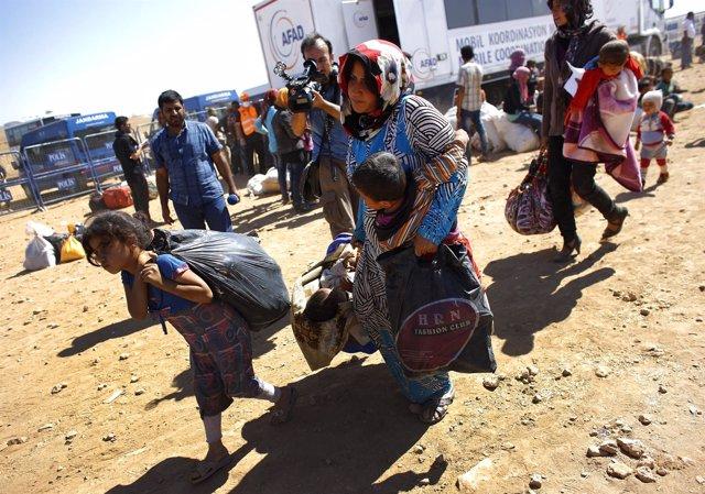 Refugiados sirios kurdos llegando a Turquía