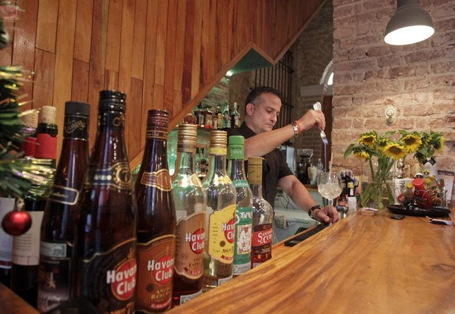 A bartender prepares a drink at a private restaurant in Havana