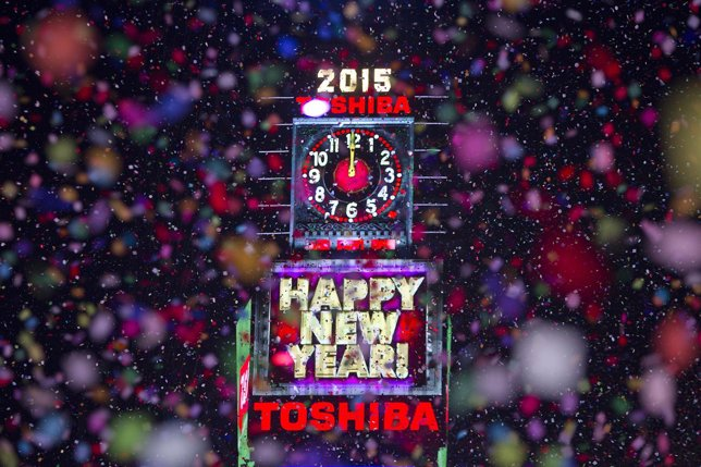 Confetti flies around the ball and countdown clock in Times Square on New Year's