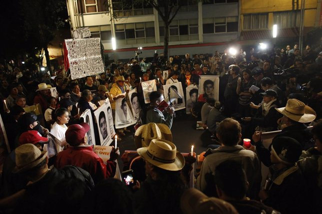 Activists and relatives of the 43 missing students of the Ayotzinapa Teacher Tra