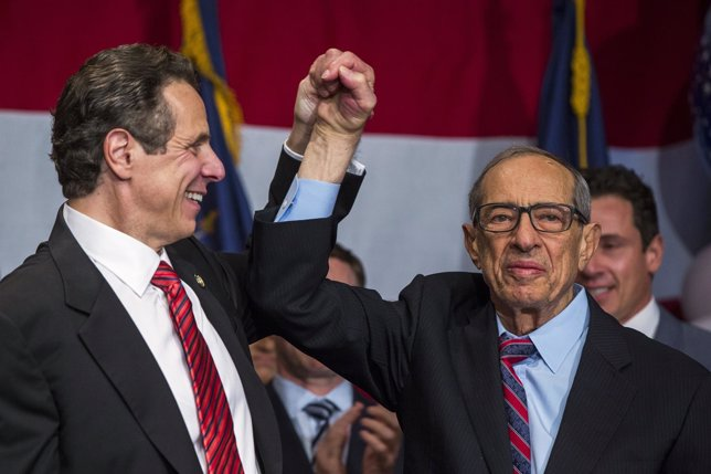 Democratic Governor Andrew Cuomo reacts with his father Mario after being re-ele