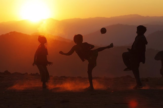Boys play with a ball in Yansi village, Donhe township in the Naga Self-Administ
