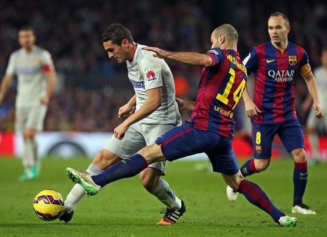 Mascherano y Koke en el Barcelona - Atlético Madrid