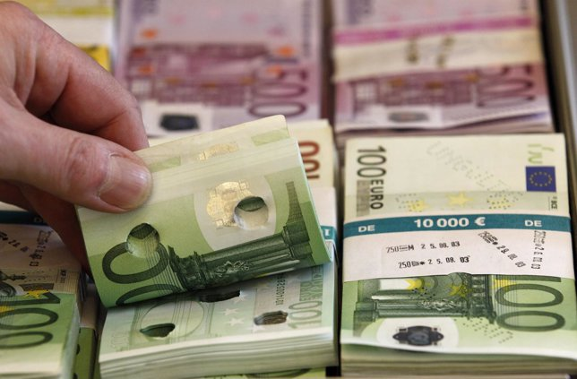 Punctured euro banknotes used for training purposes are presented during news co