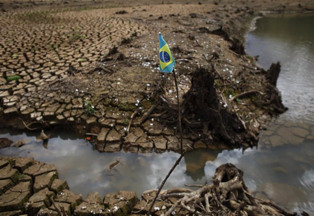 Brazilian flag is seen on the cracked ground of Atibainha dam, part of the Canta