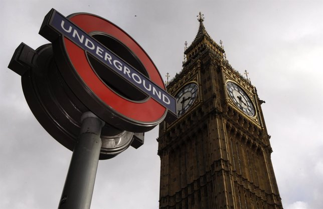 An London Underground station sign is seen in front of the Big Ben clocktower in