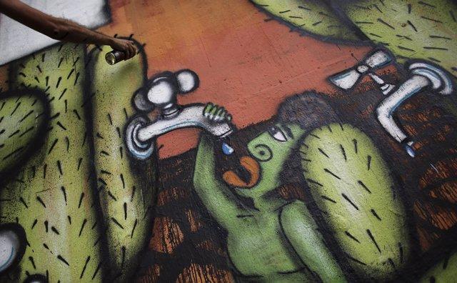 Mural del artista Mundano para denunciar la sequía en Sao Paulo
