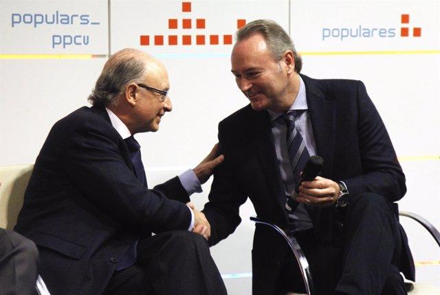 El ministro Montoro y Fabra en un acto de partido en Valencia