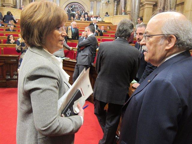 Los consellers I.Rigau y A.Mas-Colell en el pleno del Parlament