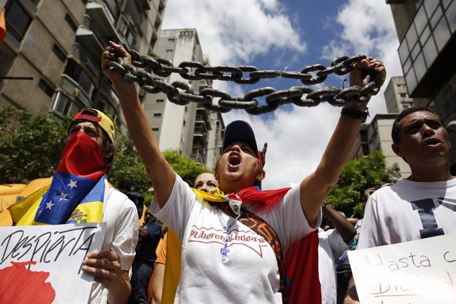 Opposition supporters shout during a gathering to protest against Venezuelan gov