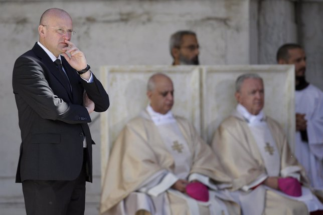 Giani, director of the Vatican Gendarmerie, looks on as Pope Benedict XVI leads