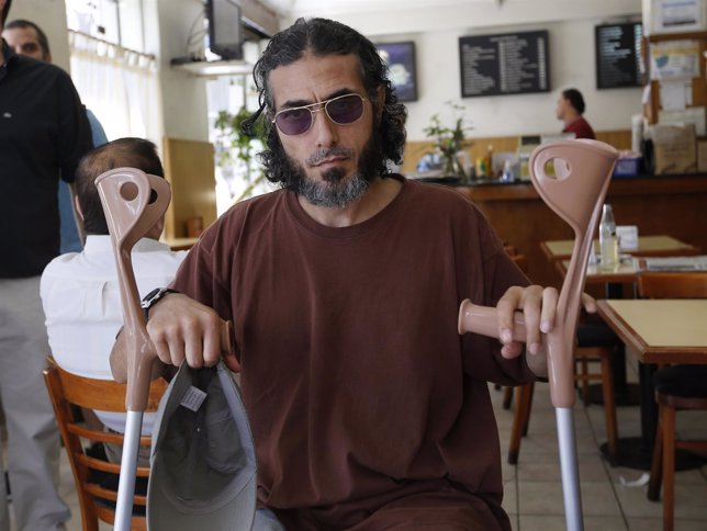 Former Guantanamo Bay prisoner Diyab, sits before an interview in Buenos Aires