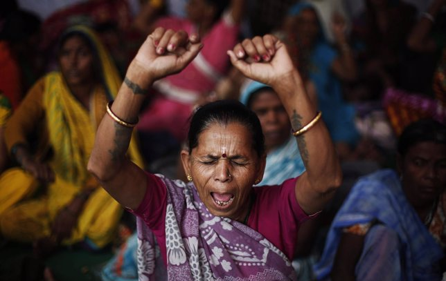 Victims of the Bhopal gas tragedy shout slogans during a sit-in protest in New D