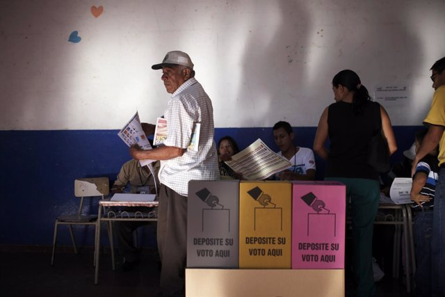 A man prepares to cast his vote during the municipal and parliamentary elections