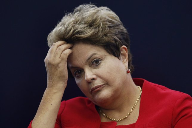 Brazil's President Dilma Rousseff reacts during a news conference on the 2014 Wo