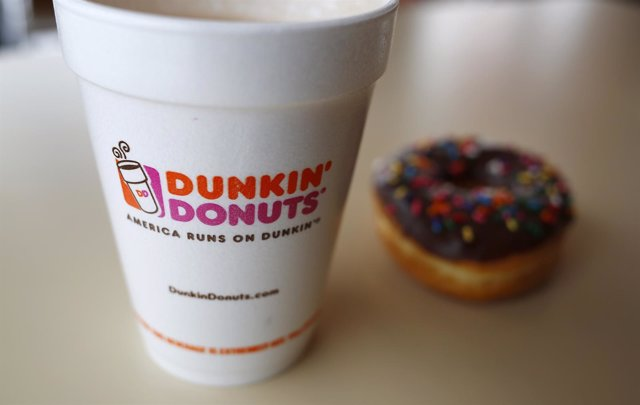 A drink and a doughnut are seen at a Dunkin' Donuts location in the Chicago subu
