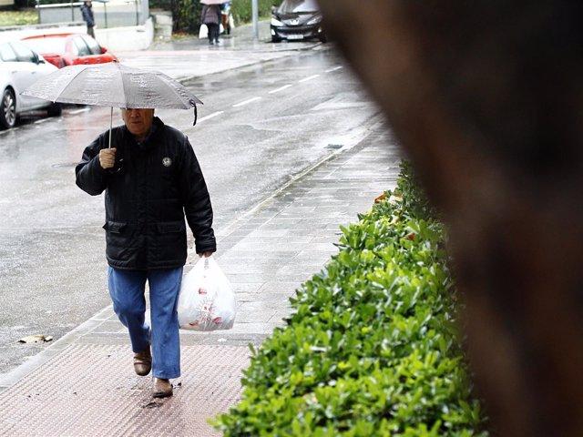 Hombre con paraguas.