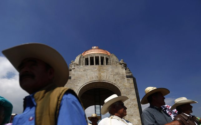 Farmers take part in a protest at Revolucion monument in Mexico City