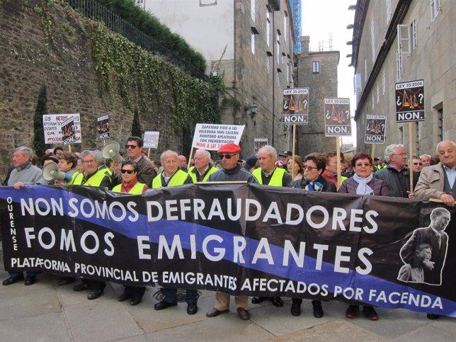 Imagen de una de las pancartas que portan los emigrantes retornados