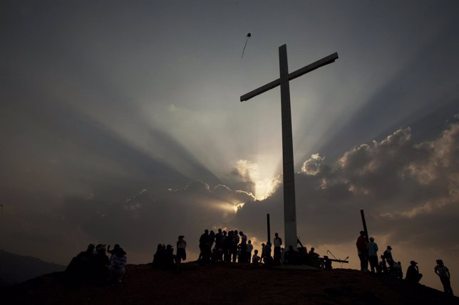 Christians take part in Via Crucis during the celebration of Good Friday at Cara