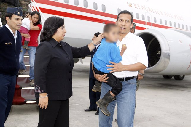 Peru's President Ollanta Humala holds a child rescued from Shining Path rebels i