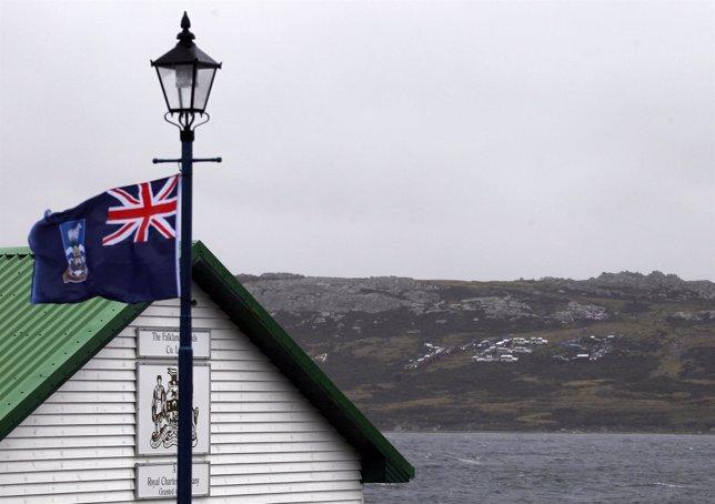 A Falkland Islands' flag waves as a