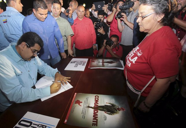 Venezuela's President Nicolas Maduro signs a public petition against U.S. Sancti