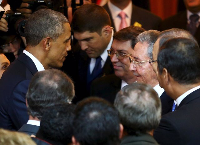U.S. President Barack Obama talks with his Cuban counterpart Raul Castro before