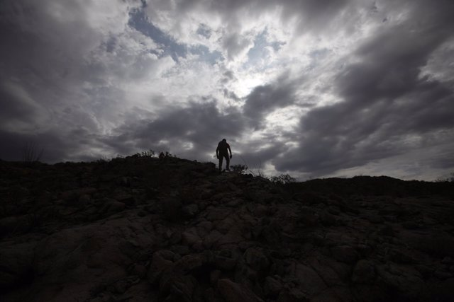 Grupo Beta member searches in the mountains between Mexico and the U.S. For pote