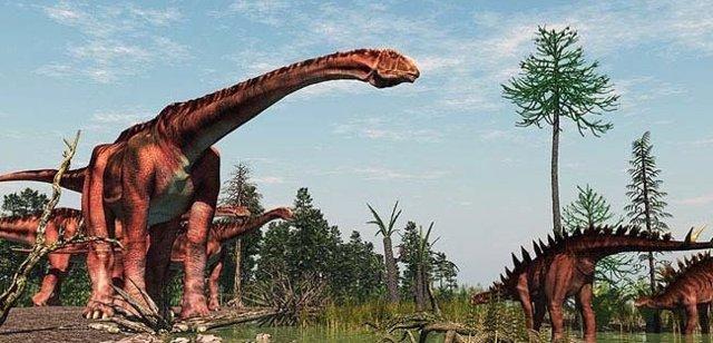 Escena con dinosaurios gigantes del tránsito Jurásico-Cretácico