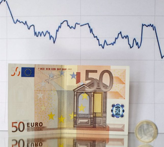 Euro banknote coin and a currency graph are placed on mirror and in this picture