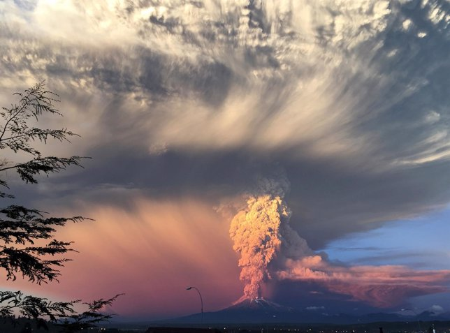 Smoke and ash rise from the Calbuco volcano as seen from the city of Puerto Mont