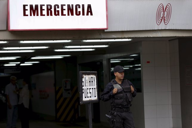 A police officer stands guard outside the clinic where arrested Caracas metropol