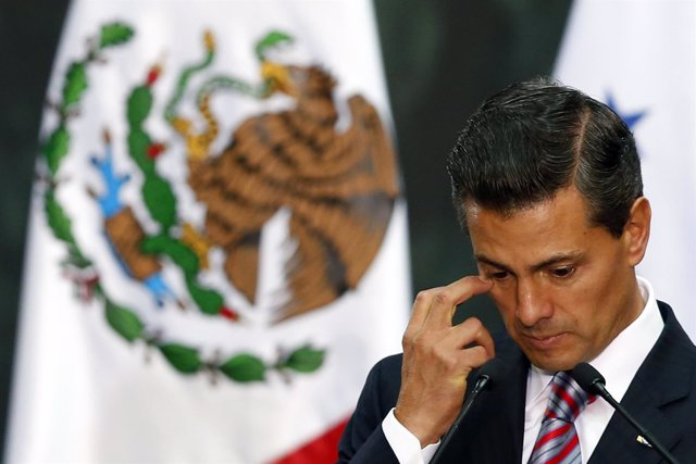 Mexico's President Enrique Pena Nieto gestures during the signature of an agreem
