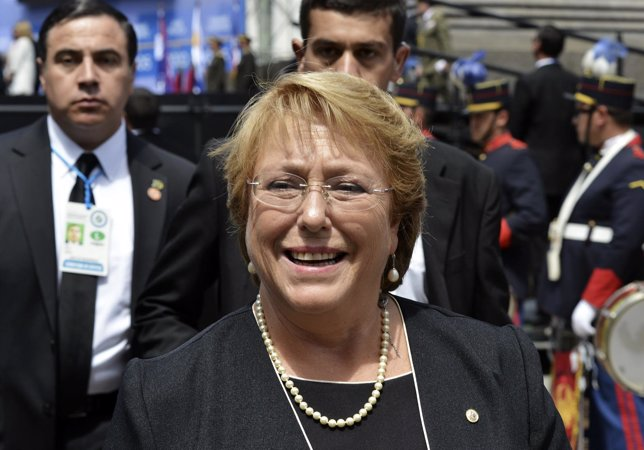 Michelle Bachelet walks after attending an event where Tabare Vazquez received t