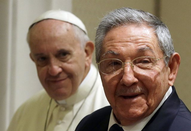 Cuban President Raul Castro smiles as he meets Pope Francis during a private aud