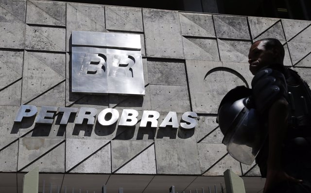 A policeman stands in front of the Petrobras headquarters during a protest in Ri