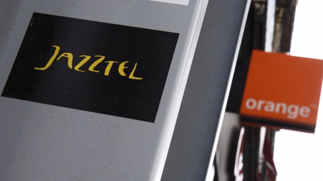 The logos of Jazztel and Orange are pictured in Madrid