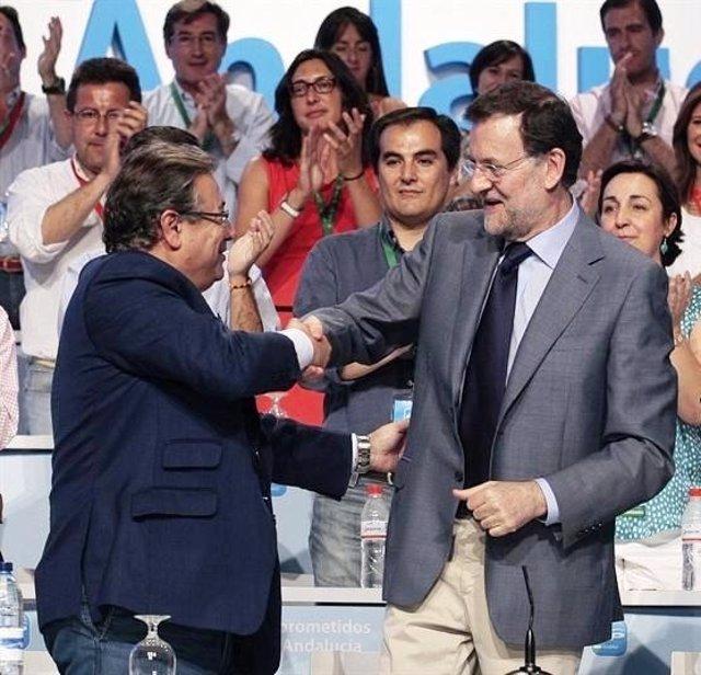 Zoido y Rajoy en un acto
