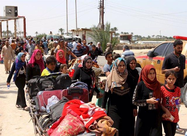 Desplazados suníes de Ramadi llegan a Bagdad.