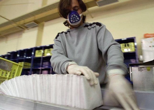 A BULGARIAN PTT WORKER SORTS LETTERS IN SOFIA.