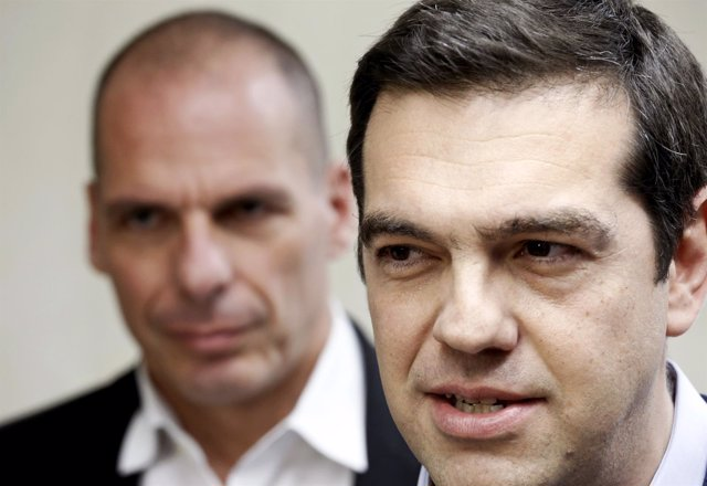 Tsipras makes statements to the media as Finance Minister Varoufakis.