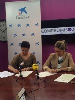 Firma de convenio entre Caixabank y Adaco