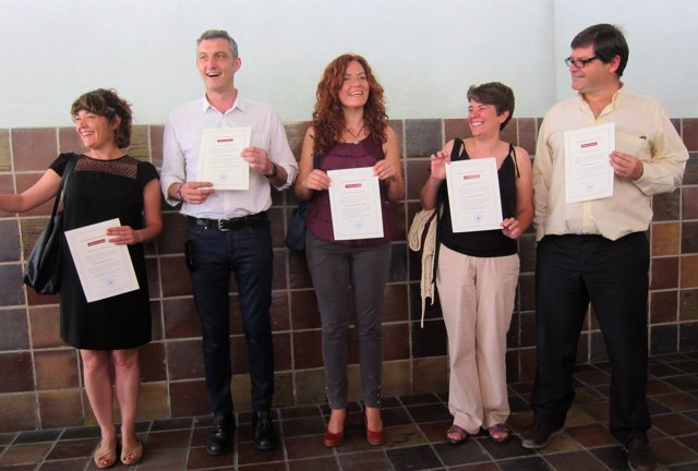 Cinco de los 6 diputados electos de Podemos tras recoger credencial