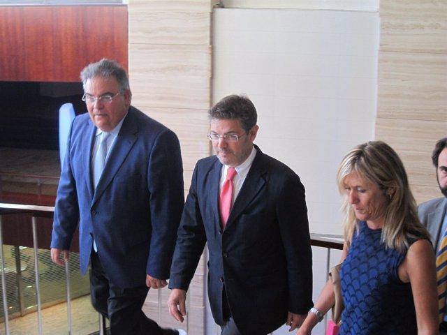 El ministro de Justicia, Rafael Catalá, y la delegada Teresa Palmer