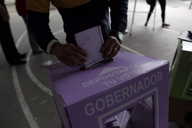 Man casts his ballot at a polling station during mid-term elections in the town